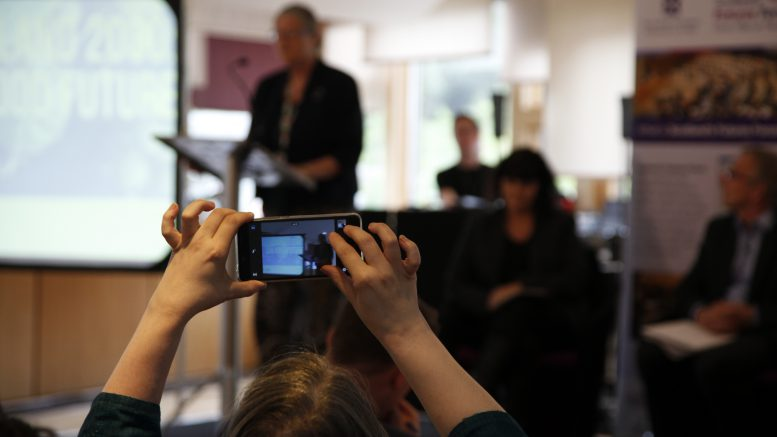 Audience member takes a photo of Claudia Beamish MSP as she chairs the Futures Forum event on Our Food Future. Pic - Fiona MacLellan